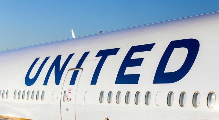 """the side of a united airlines (UAL) plane with """"united"""" written above passenger windows"""