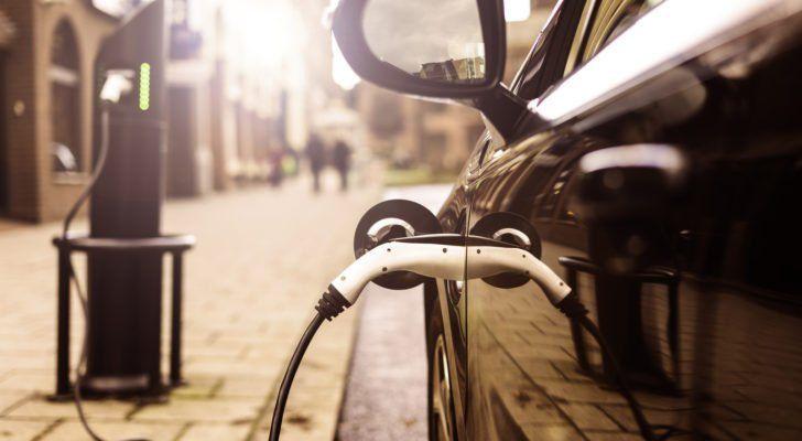 an electric vehicle charging. image represents ev stocks like fsr stock
