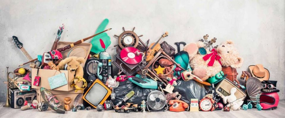 Old antiques and retro collectibles memorabilia dumped in a huge pile.