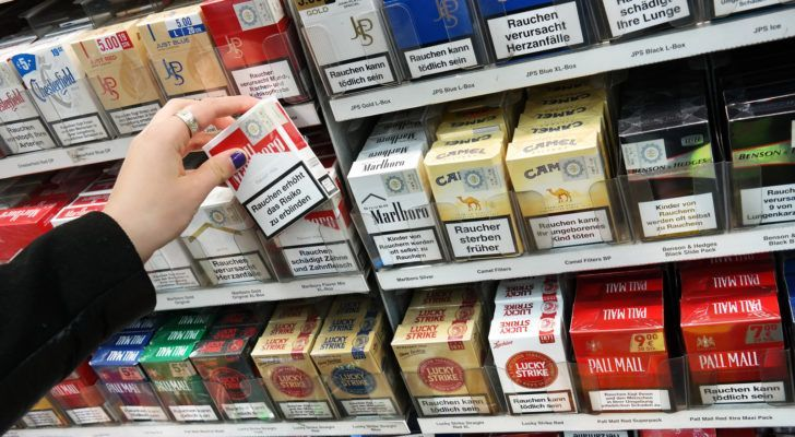 packs of cigarettes in convenience store rack