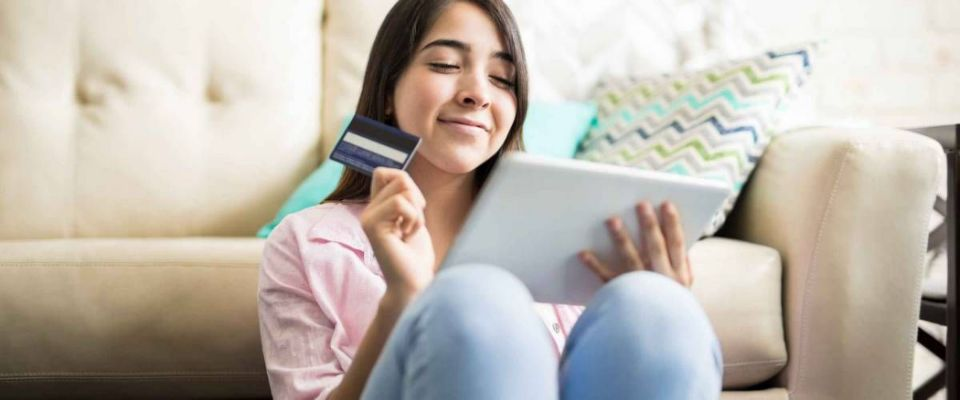 Young woman excited about shopping online