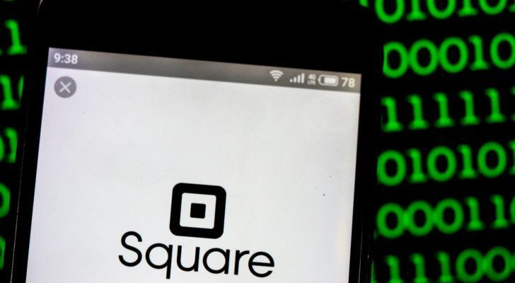 Square, Inc. (SQ) logo seen displayed on smart phone. Square, Inc. is a financial services, merchant services aggregator, and mobile payment company