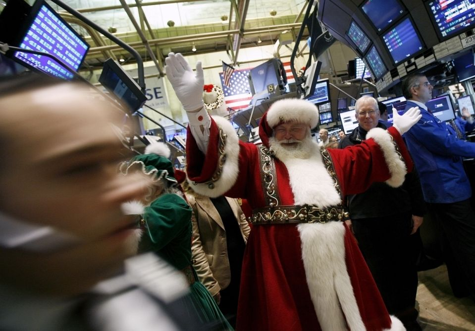 A man dressed as Santa Claus walks the floor of the New York Stock Exchange, November 24, 2008. U.S. stocks rose further on Monday after data showed U.S. existing-home sales fell in October about in line with expectations, adding to earlier gains on the government's $20 billion injection of new capital into Citigroup.    REUTERS/Shannon Stapleton (UNITED STATES)