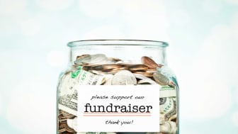 picture of jar for charitable donations with money in it