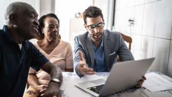 Senior couple having a consultation with a financial advisor at home