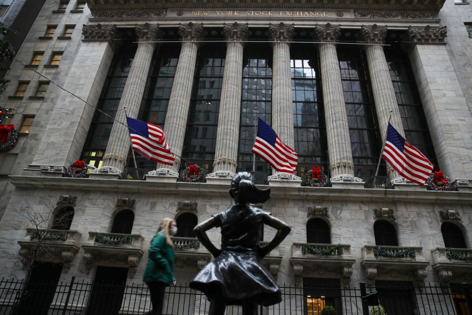 """NEW YORK, USA - NOVEMBER 30: New York Stock Exchange building is seen decorated for Christmas at the Financial District in New York City, United States on November 30, 2020. New York is ranked as one of the largest International Financial Centres (""""IFC"""") in the world, now seen so quiet due the Covid-19 pandemic. (Photo by Tayfun Cokun/Anadolu Agency via Getty Images)"""