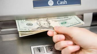 Withdrawing money at an ATM.